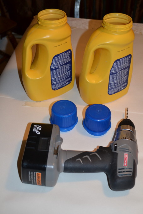 To make your kid-size watering can, you will need some empty laundry detergent jugs and a drill.