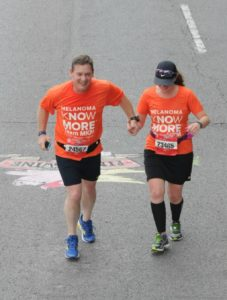 "Crossing the ""Finish Swine"" with my dad at the Flying Pig 10k"