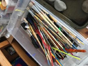 Paint brushes in bin