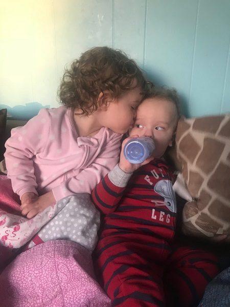 Boy and girl twins cuddling