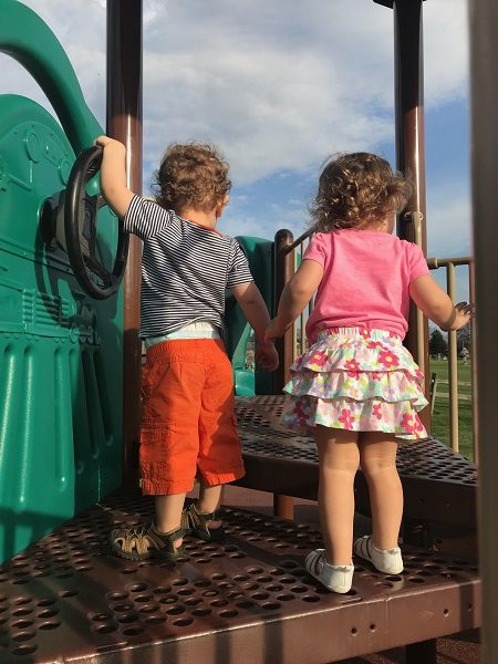 Boy and girl twins at park