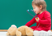 Child with Teddy Bear and Stethoscope Pediatrician Guide Featured Image