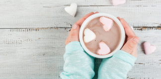 February Family Events Featured Image - Hands holding hot chocolate with heart marshmallows
