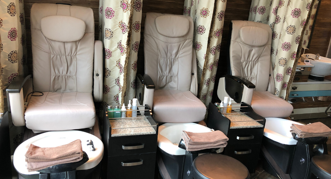 Large, padded, beige pedicure chairs at The Spa at Dollwood's DreamMore Resort