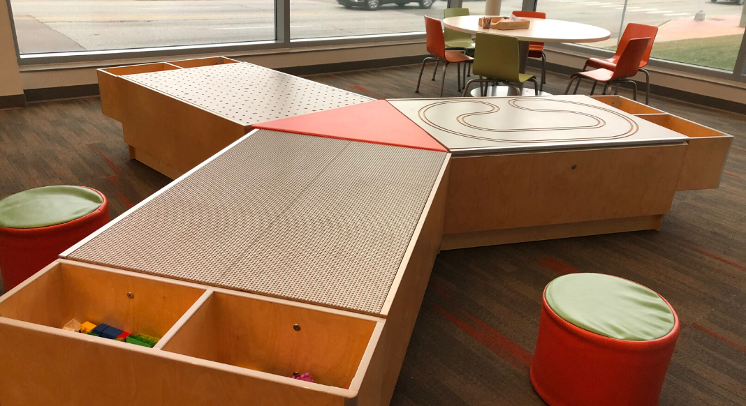 A brown and orange multi-use kid's table for trains, building blocks, and Legos at the Reading Branch of the Hamilton County Library