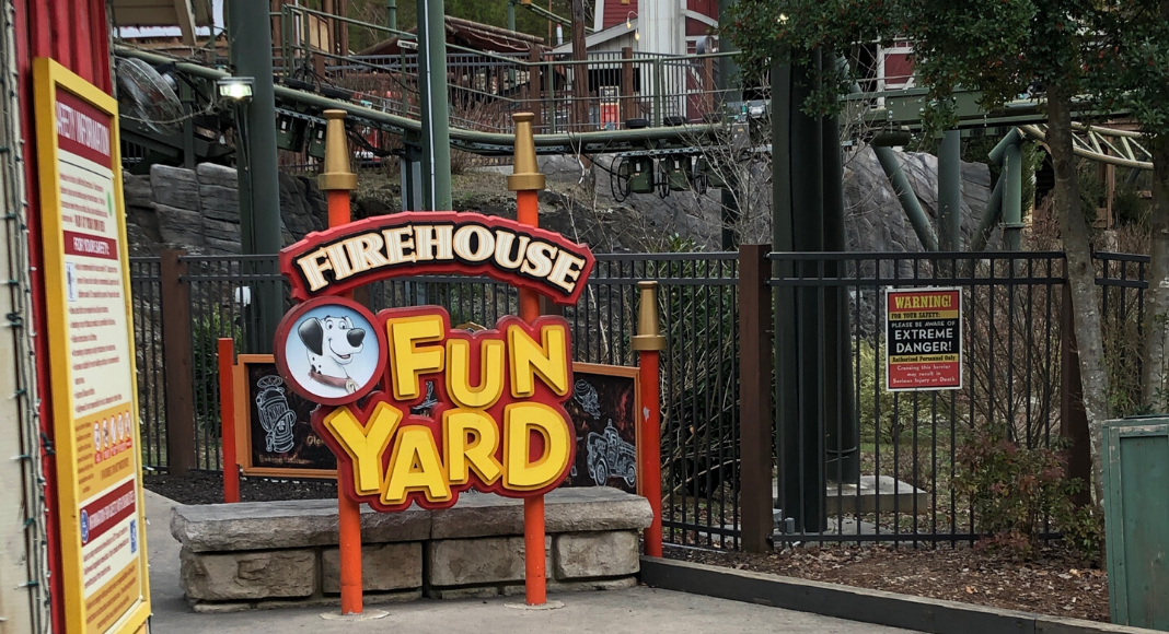 Firehouse Fun Yard sign in front of a Steele rollercoaster at Dollywood Amusement Park