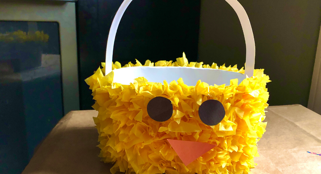 An empty Hudsonville Ice Cream carton decorated as a chick for Easter.
